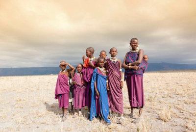 masai woman and a children in the african savannah
