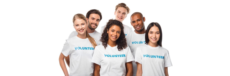 volunteers in white shirt smiling